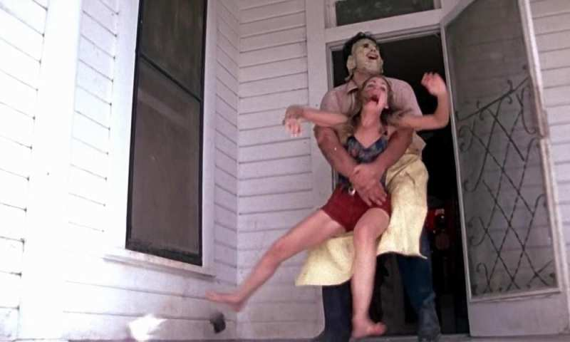 a woman is grabbed by a man dressed in someone else's skin