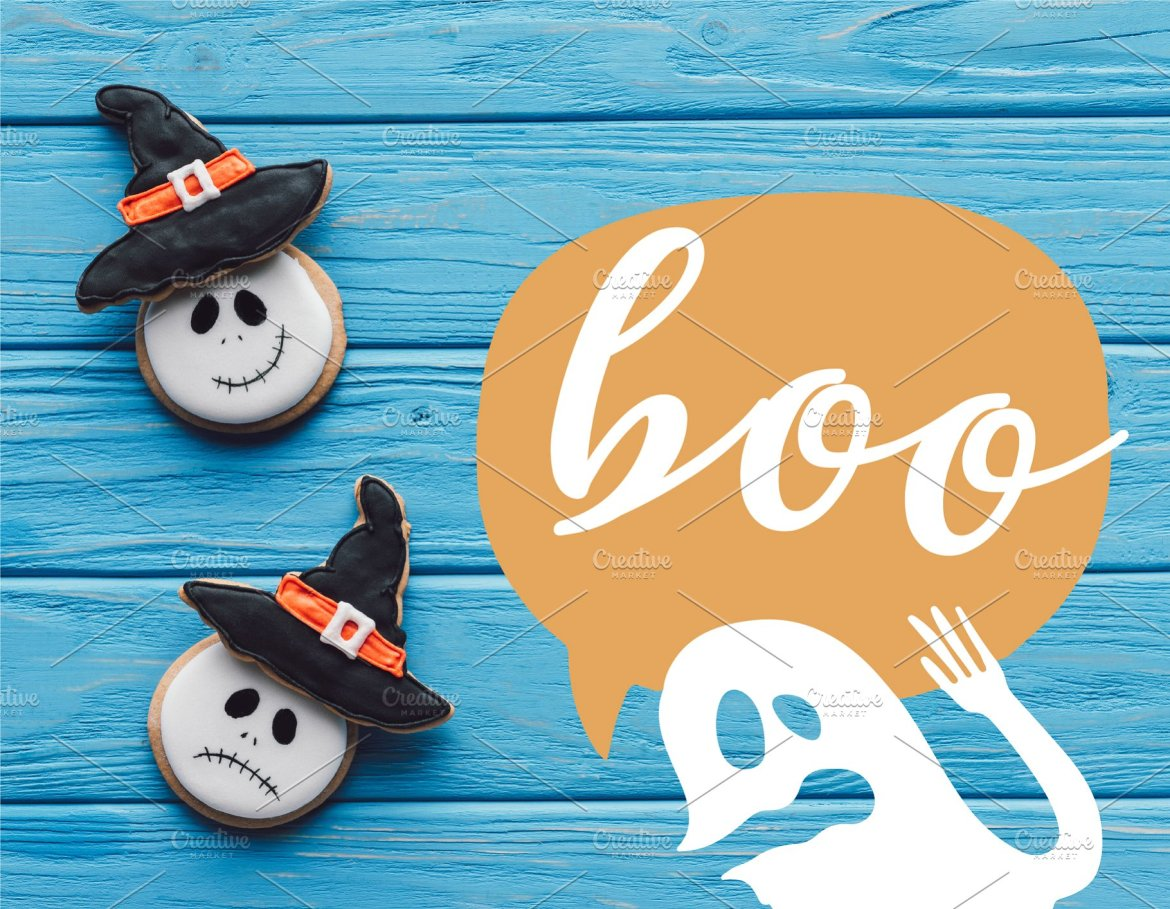 Delicious Homemade Halloween Cookies on Wooden Background with Ghost and Boo Lettering Web3Canvas