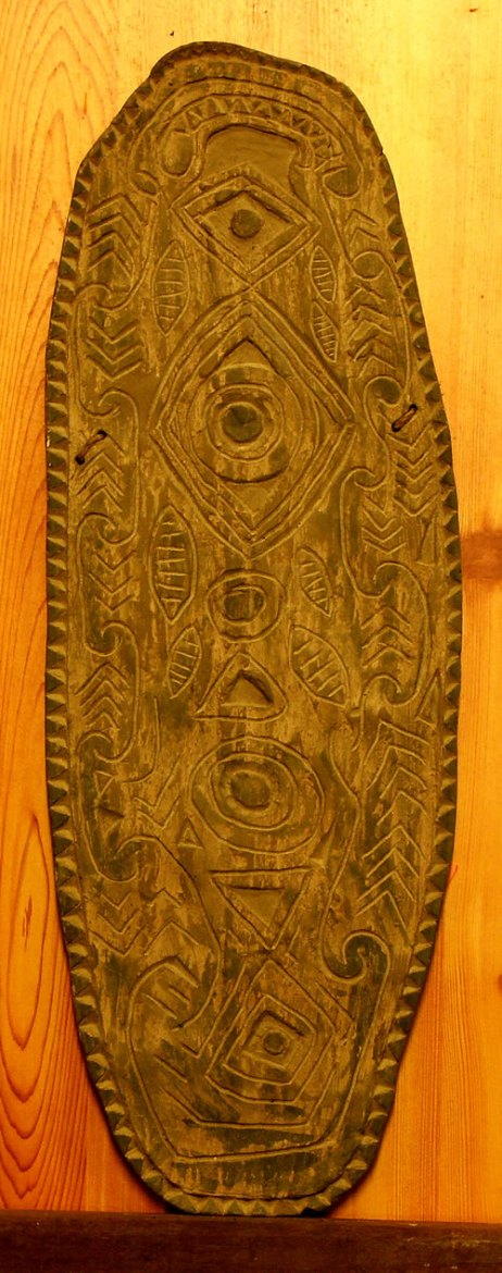 Copy of a timber shield from the Grass Country of the Upper Sepik, where tribal warfare still erupts from time to time..