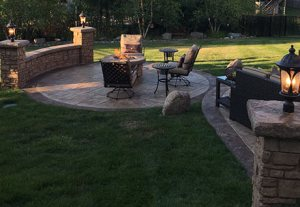 Residential Stamped Concrete Patio and Fireplace Evening