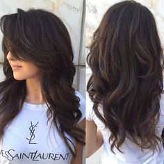 long layered hairstyle for thick hair and side swept bangs