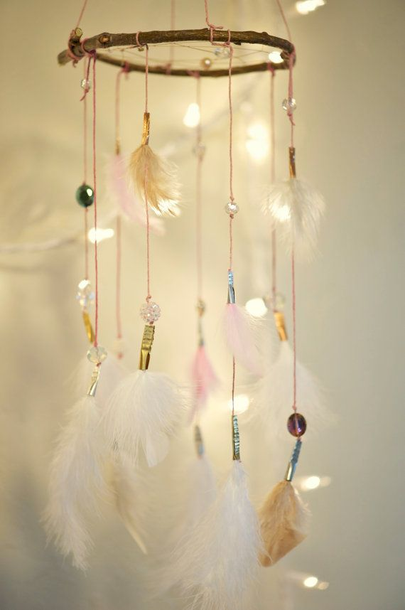 This is so soft and subtle, with its white, cream, and pink feathers. It features pink string and gold, si