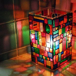 This Stained Glass Mosaic Lamp looks stunningly gorgeous, but it's simple enough for a kid to make! Just l