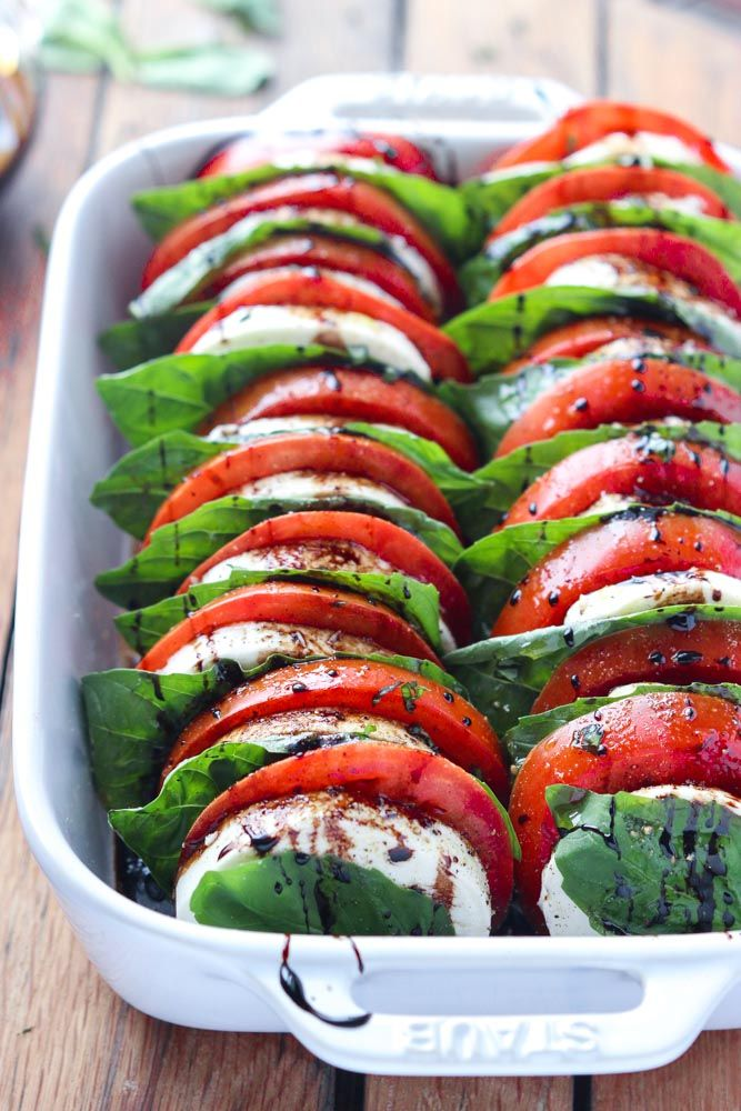 Light and easy appetizer or salad, loaded with tomatoes, fresh mozzarella, basil and balsamic reduction.