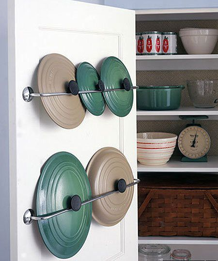 Finally, store kitchen items like pot lids on the back of cupboard doors using towel racks and gravity
