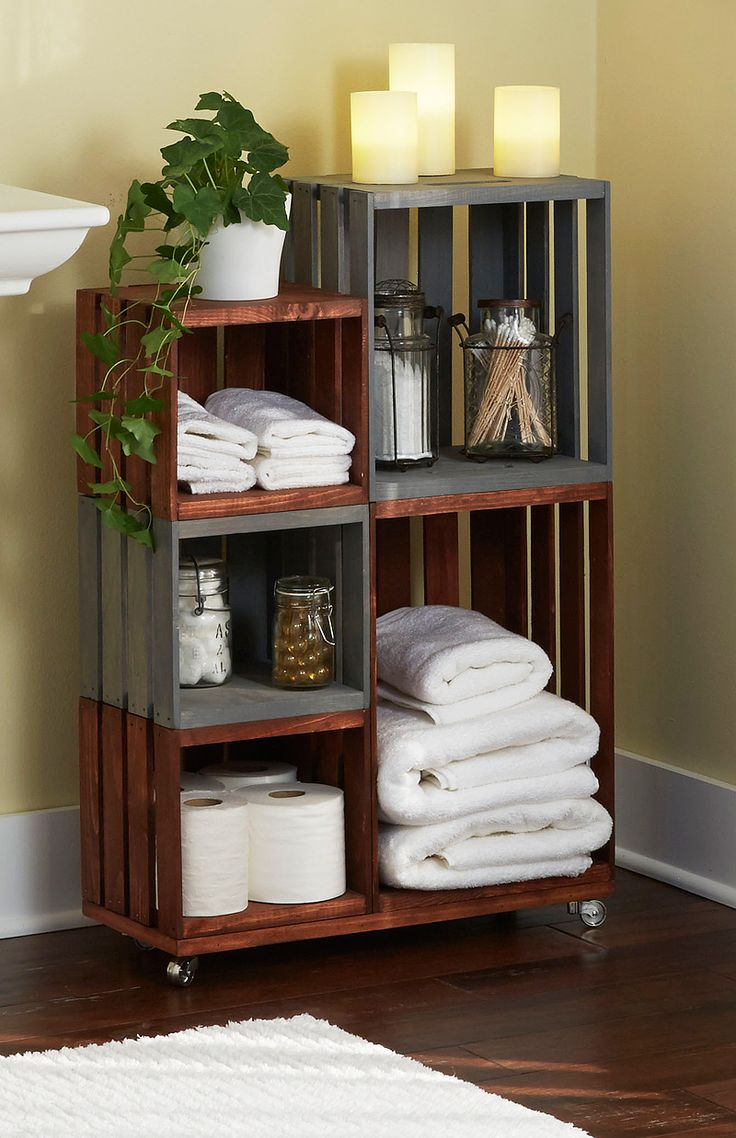 Bathroom storage on wheels!  Ordinary wooden crates come together for this attractive and handy bathro