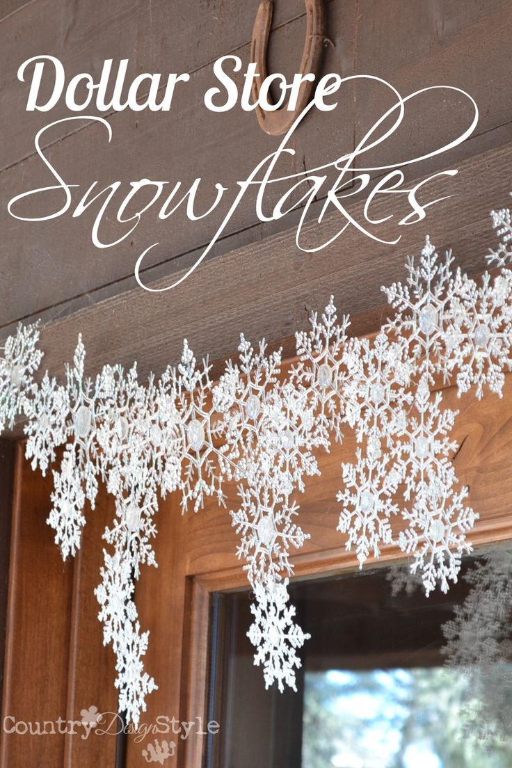 Melting snowflakes with a hot glue gun! Dollar store snowflakes hanging over our f