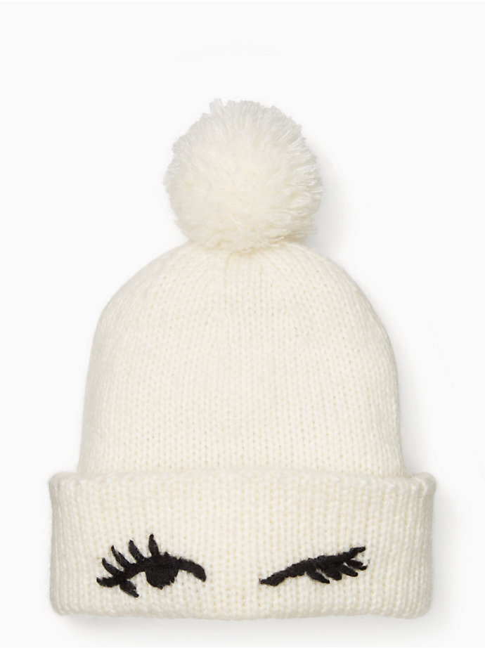 eyes up here: this adorable knit beanie is finished with a wink, resulting in a st