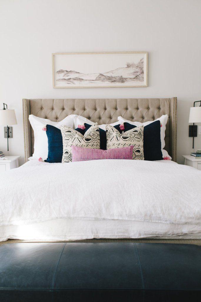 feminine bedroom with tufted headboard