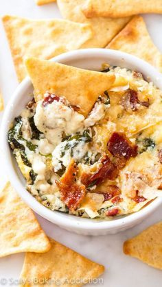 Creamy warm spinach dip made with roasted garlic, crispy bacon, and parmesan chees