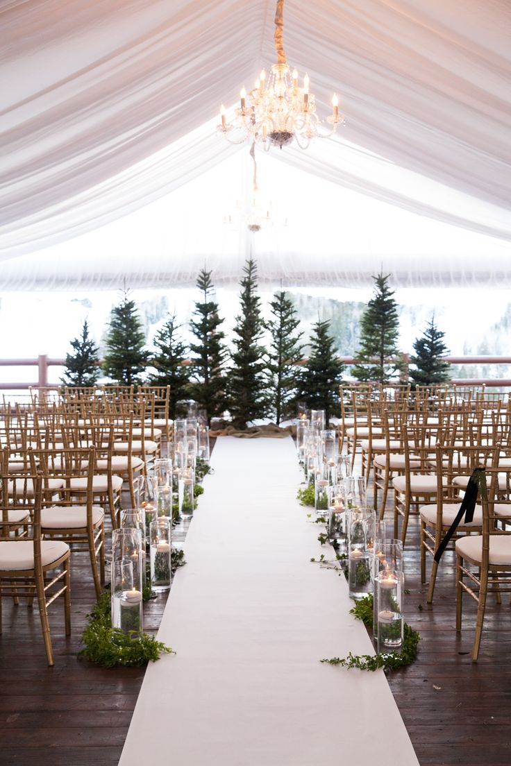 Tented wedding ceremony with evergreen trees and candles | Winter wedding at Stein