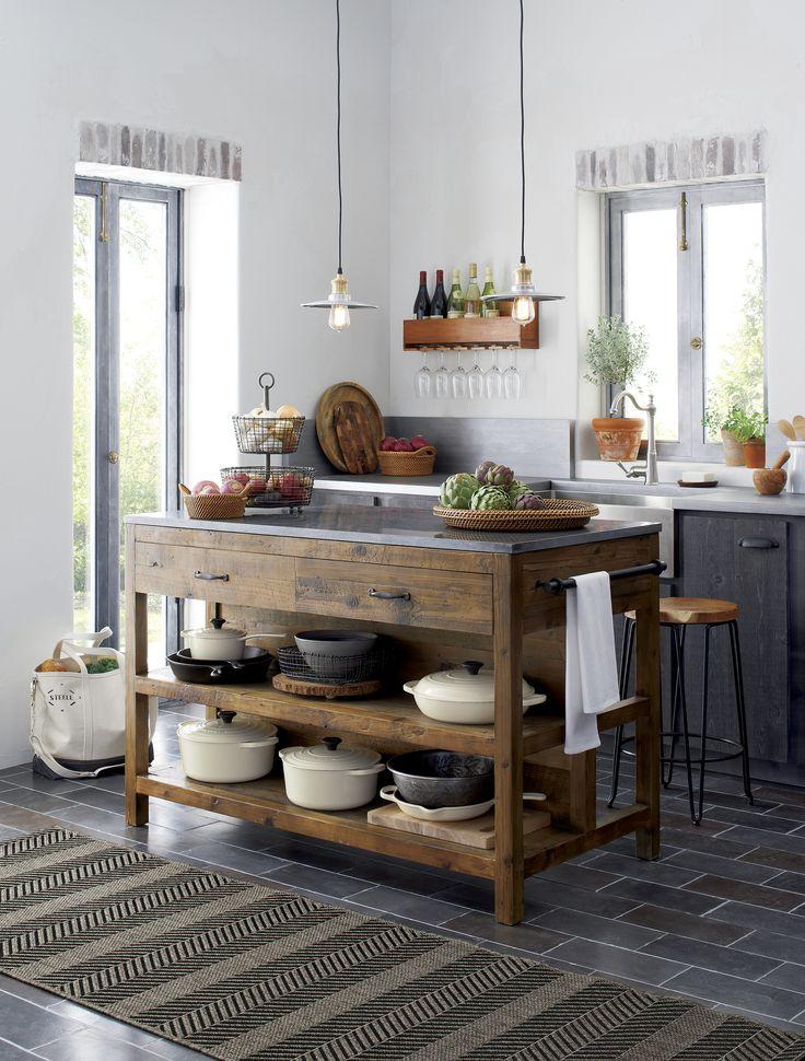 Like a treasured vintage find or a custom-designed piece, this elegant kitchen isl