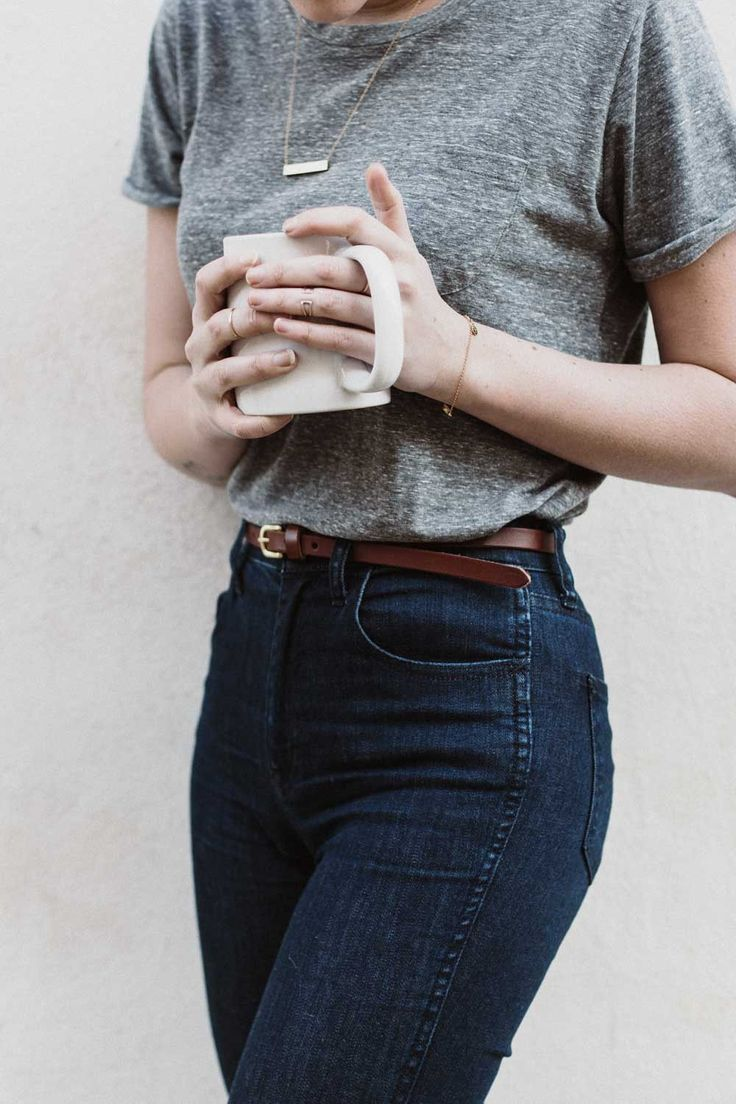 A classic and simple look can never go wrong. The high wasted jeans with the belt, simple piece of jewelry ALL complement each