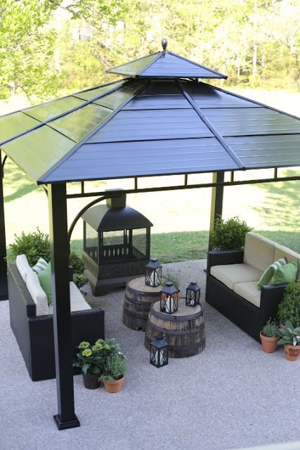 Anchor your outdoor space with a gazebo that provides shelter for a comfortable seating area and cozy fireplace. Groupings of