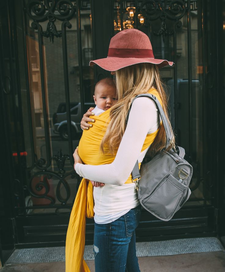 fall floppy hat & yellow baby wrap are cute accessories on this mama