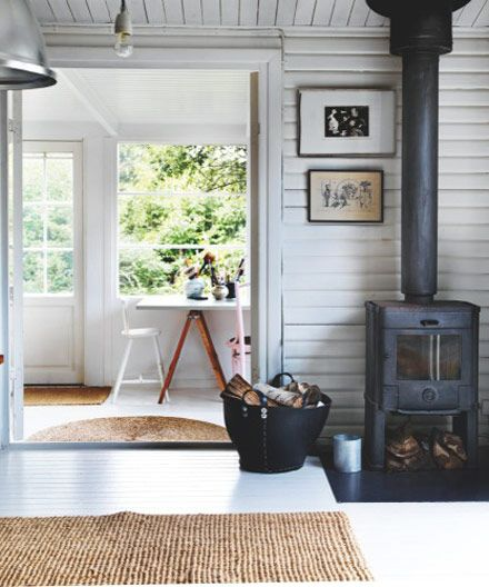 Simple, rustic summer house, cottage.  horizontal, painted plank walls.  Denmark.