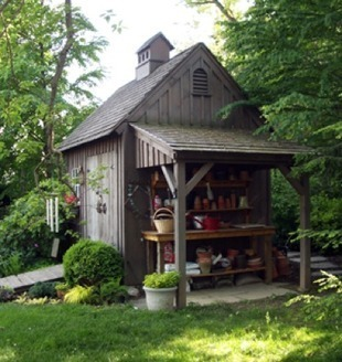 Nice shed with attached potting bench with cover. Also note the double doors and ramp.