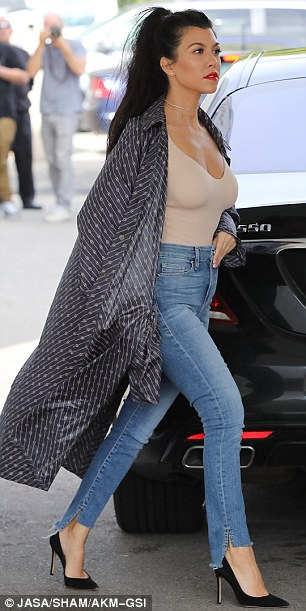 Showstopper:The mother of three opted to wear medium wash bottoms from Khloe's denim company Good American