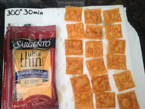 Cheez-Its These, to me, taste just like Cheez-Its.  Cut each Ultra Thin Sargento Sharp Cheddar Cheese slice into quarters, place