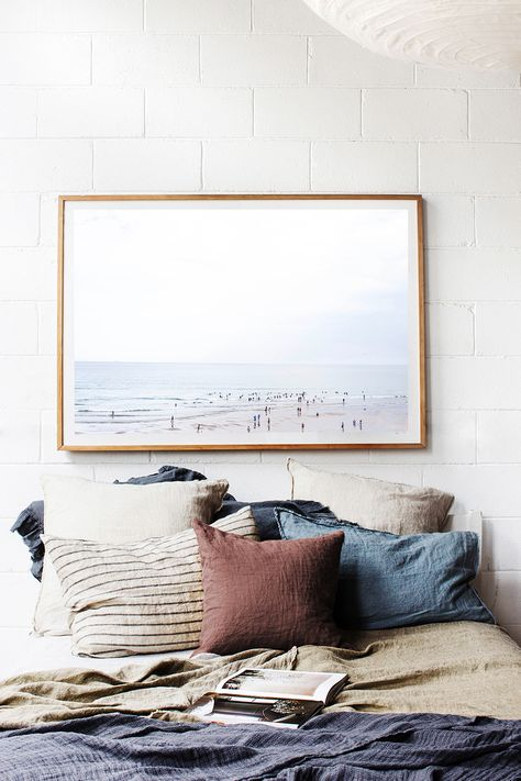 Bedroom inspiration – Lots of neutral pillows, minimalist artwork, and blankets