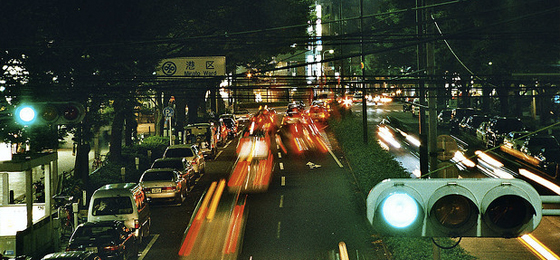 Tokyo Prefecture - night traffic at stop lights