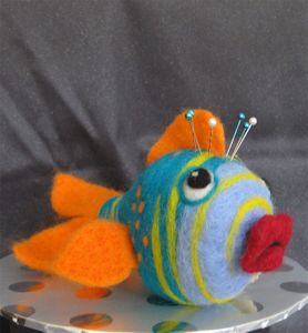 """Fish"" hidden tapemeasure needle felted"