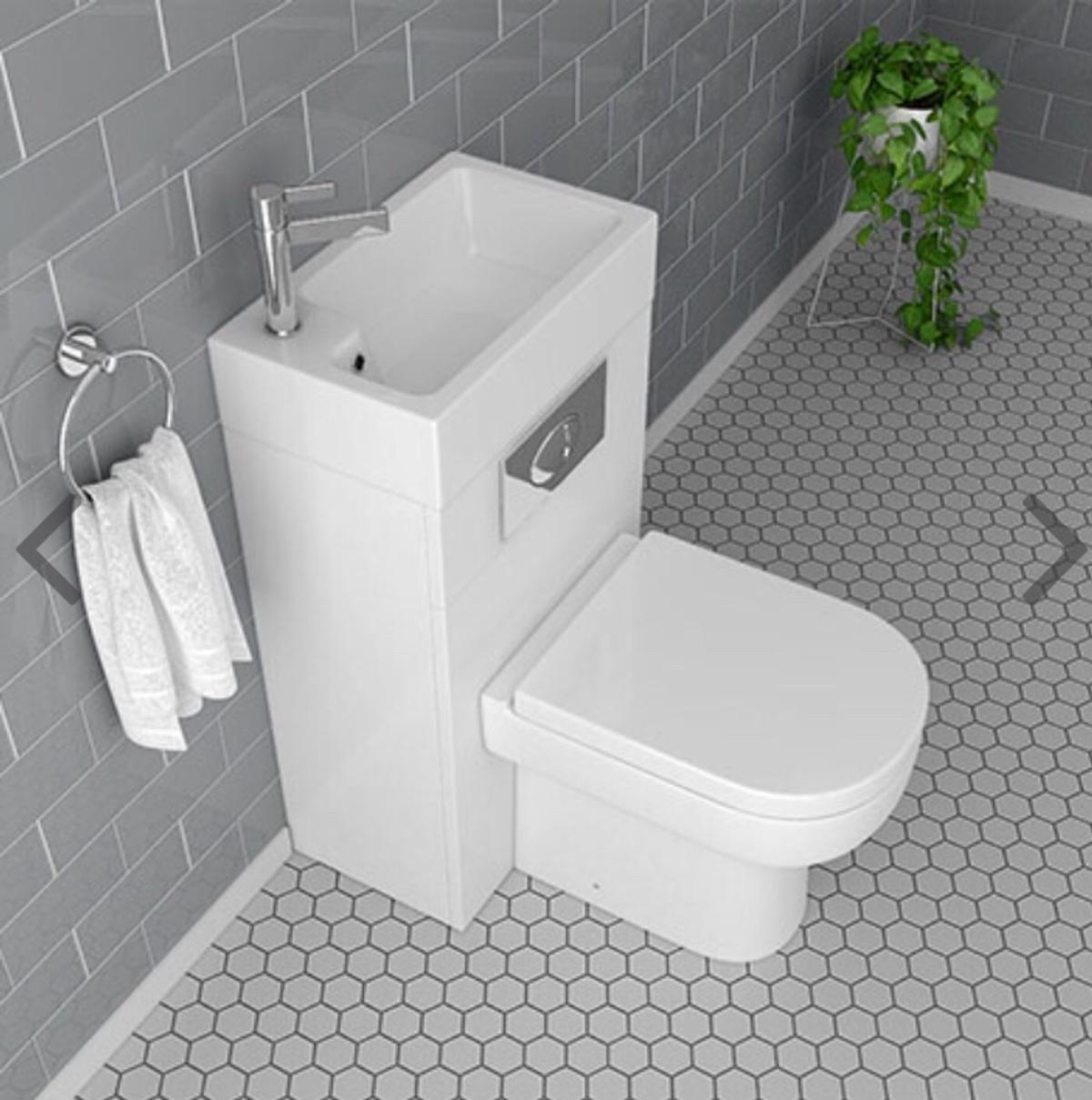 toilet and sink attached