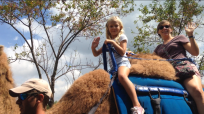 Anabel and Duffy riding a camel
