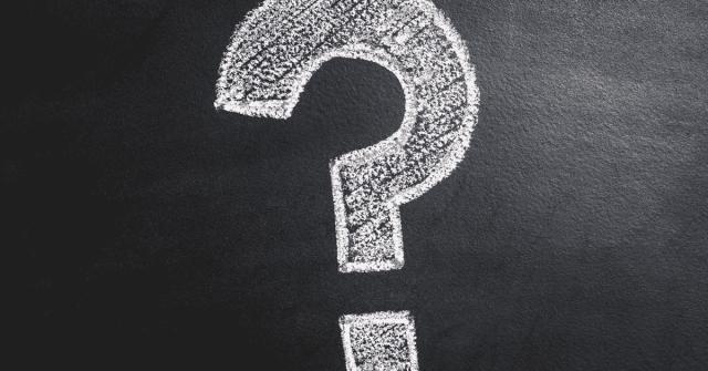 A question mark on a chalkboard