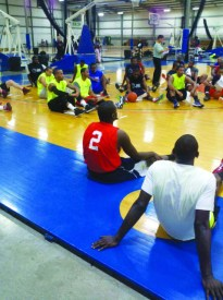 Toreyon Times, Webster University baseketball player in the 2010 -11 season, sits with other players at the USA Sports Academy in Columbus, Ohio on Sept. 28. He was one of 66 players invited to a showcase for NBA scouts. PHOTO CONTRIBUTED BY TOREYON TIMES