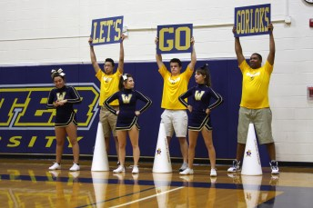 "HOLLY SWAN / The Journal Webster University cheerleaders chant ""Let's go Gorloks"" on the side line at the Gorlok's basketball game Tuesday."