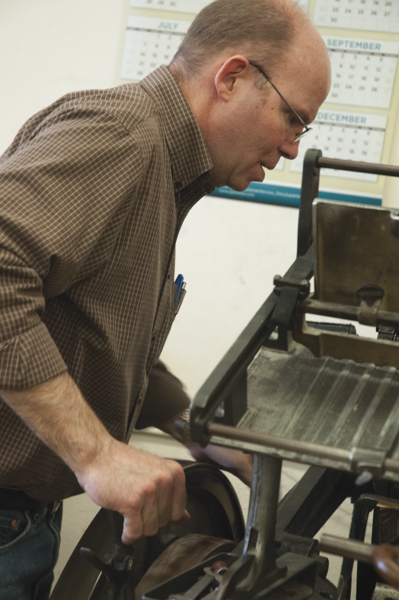 Dan Rath uses a Kluge machine to add sequential numbering to business forms.  PHOTOS BY MEGAN WASHAUSEN/The Journal