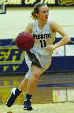MEGAN FAVIGNANO / The Journal Kaliann Rikard dribbles the ball down the court Saturday, Feb. 22 at Webster's game against Eureka College