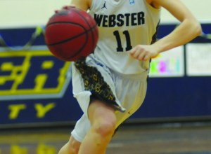 MEGAN FAVIGNANO / The Journal Kaliann Rikard dribbles the ball down the court Saturday, Feb. 22 at Webster's game against Eureka College
