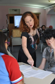 Adjunct Professor Terri Reilly helps a student in one of her classes. She was elected as Faculty Senate's first adjunct member in 2014.