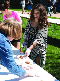 DAVID BROOME / The Journal Ashley Villareal, a student volunteer, helps by filling the tacos with beans.
