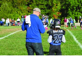 Photo Contributed by Tony Bryan Tony Bryan coaches his 11-year-old son Elijah's football team. Bryan and his wife of nearly 20 years have four children.