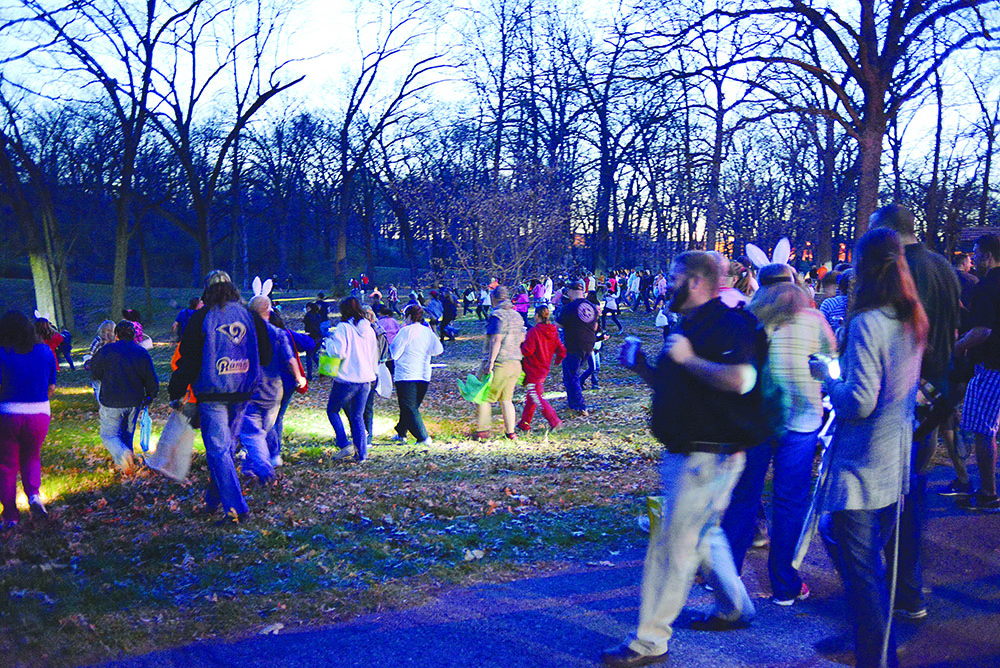 DAVID BROOME / The Journal Adults participate in Jefferson Barracks adult Easter egg hunt on Friday, April 11. According to Park Facility Recreational Coordinator Susan Tornetto, there were $10,000 in hidden prizes.