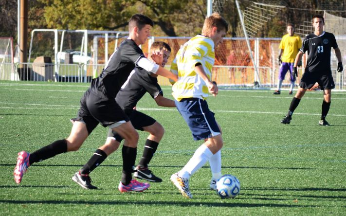 Dino Music on the ball against Fontbonne University on Nov. 1 PHOTO BY JORDAN PALMER/THE JOURNAL
