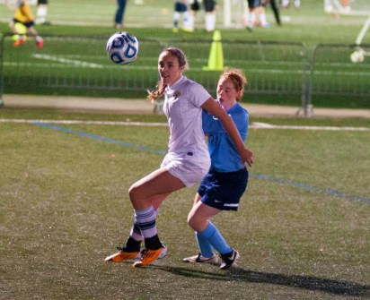 Julia Peschel / The Journal Senior forward Kristin Montgomery fights for the ball in Webster's 2-1 victory over Westminster in the SLIAC semifinal on Nov. 5. Montgomery scored the first goal of the game in the 57th minute.