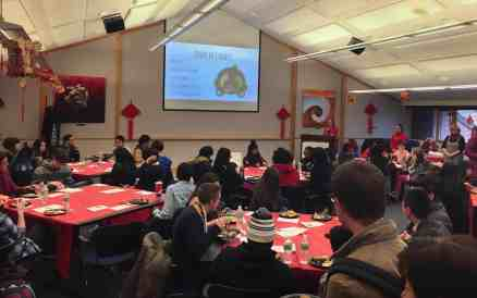 Students and faculty gather in the Sunnen Lounge to celebrate the Chinese New Year. YUE ZHANG / The Journal