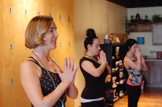 STL Symphony Associate Concertmaster Heidi Harris teaches a class at Agape Yoga Studio. Harris is teaching a workshop for Webster music students about how to use yoga to help perform to the best of their ability. JARROD PHILLIPS / The Journal