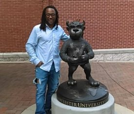 Chorsie Martin poses next to Webster's new Gorlok statue Aug. 1. | Contributed photo