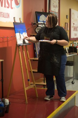 Dion Allison teaches a class at Painting with a Twist. HAYLEY ABSHEAR / The Journal