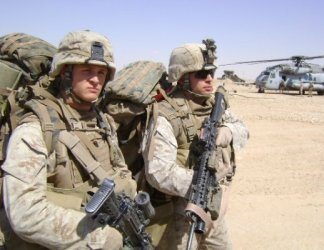 Photo Credit: Mike Nowicki Tom Palozola and Mike Nowicki serving in Iraq together in 2007.