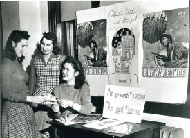Photo Credit: Webster University Webster students sell war bonds during World War II on campus.