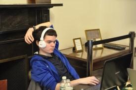 Illia Nyzhnyk watches his teammates play live on his computer
