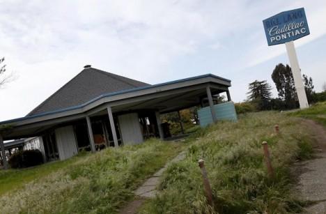 abandoned Cadillac dealer homeless shelter Vallejo fire