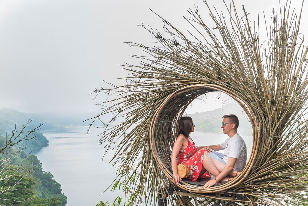 We Collect Postcards travel couple at the nest of Buyan Lake in Bali Island, Indonesia