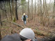 Using the winch to move a log on the trail.